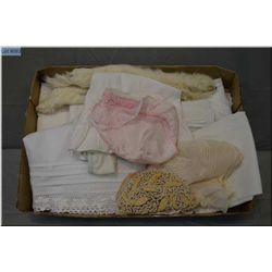 Selection of vintage dolls white wear including slips, pantaloons, baby hats, beaded hat and two erm