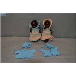 """Two small 4 1/2"""" composition baby dolls in knitted outfits, with extra hand knit sweaters and hats"""