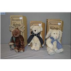 Three boxed Boyds Collections plush toys including bear, moose and rabbit toys