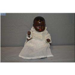 "11"" Huebach Kopplesdorf 414 black baby doll with sleep eyes, composition body, open mouth, one earri"