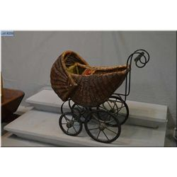 Small vintage wicker doll buggy