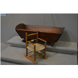 Primitive wooden cradle and a small dolls chair with rush seat