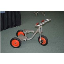 Unique well built Childs tricycle with spring seat, heavy duty platform and wheels. Ward grandchildr