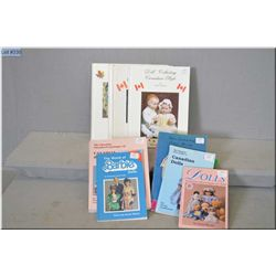 Selection of dolls reference guides including Barbie and Canadian doll guides etc.