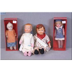 Four composition dolls including two new in box, a small composition baby doll on stuffed body with
