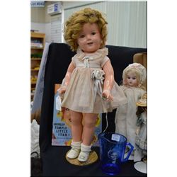 Composition Shirley Temple doll with book and jug