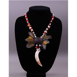 Unique tribal necklace with feathers and boar's tooth