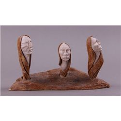 Shawn Thomas stone carving of three heads.  Iroquois