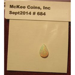 684. Genuine .60 carat Tear drop shape Opal.