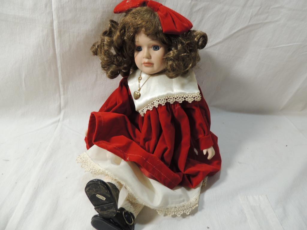 PORCELAIN DOLL IN RED VELVET DRESS