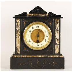 Black Marble Mantle Clock with Etched Decoration.