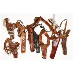 Collection of 8 Single Rig Shoulder Holsters.