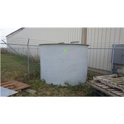 Fiberglass tank in corner of yard