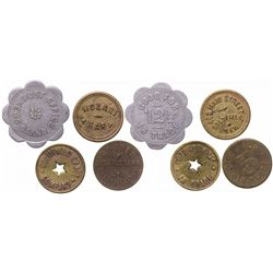 Four Goldfield tokens: Rhodes Cigar, Mozart Bar, Goldfield Candy, Post Office News Stand