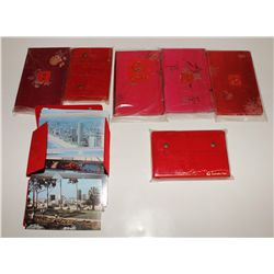 Four Chinese stamp albums and three Australian post card albums