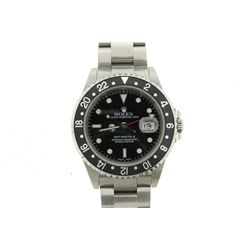 WATCH: [1] Men's St. Steel Rolex O.P. GMT Master II date wristwatch; black dial; bi-directional beze