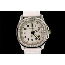 WATCH: [1] Ladies St. Steel Patek Philippe Aquanaut diamond wristwatch; 33.7mm cushion case; white t