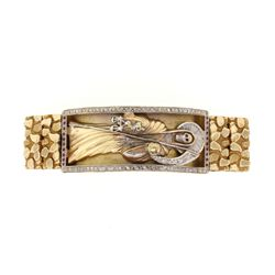 BRACELET: [1] 14ky and wag (tested) and diamond bracelet. 9 1/2'' long x 1 1/4'' wide. Center gold s