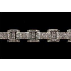BRACELET: [1] Men's 14kw ''invisible'' set diamond link bracelet; 500 square princess diamonds, 2.2m