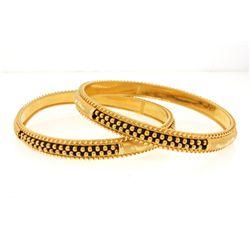 BRACELETS:  [2] 22KYG bangle bracelets with black beads; 47.4 grams