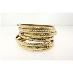 BRACELETS:  [1] 10KYG matching set of 5 hinged bangle bracelets;  41.9 total grams