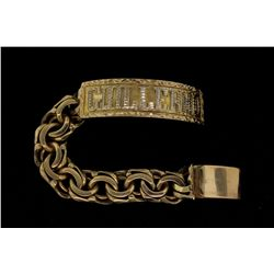BRACELET:  [1] 10KYG 'Guillermo' ID bracelet with rhodium plated accents; 7''s; 59.0 grams
