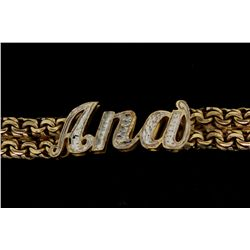 BRACELET:  [1] 10KYG 'Ana' ID bracelet with rhodium plated accents; 6 1/2''s; 45.7 grams