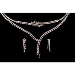 SUITE:  [1] 18KWG suite with matching necklace, bracelet and earrings set with 337 round diamonds, a