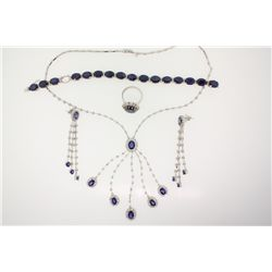SUITE:  [1] 18KWG suite with matching necklace, bracelet, ring and earrings set with 31 blue sapphir
