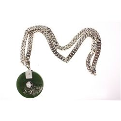 CHAIN: [1] Gents 18kw curb chain; box clasp, 20 inches long, 7.01mm wide; 61.1 grams.  PENDANT: [1]