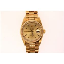 WATCH: [1] Men's 18ky Rolex O. P. Day Date wristwatch; champagne dial w/ stick markers; fluted bezel