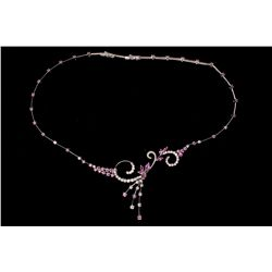 NECKLACE: [1] Ladies 18kwg pink sapphire and diamond necklace 17'' long to tip. Spray design at