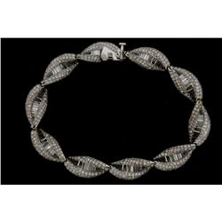 BRACELET: [1] 18kwg and diamond bracelet 8'' long twist design 10mm wide pave set with (860) rbc dia