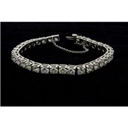 BRACELET: [1] Platinum (stamped) and diamond straight line motif bracelet (33) 5mm rbc diamonds VS2