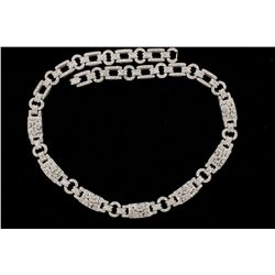 NECKLACE: [1] 18kwg and diamond link necklace 18'' long x 10mm wide, geometric open work design with