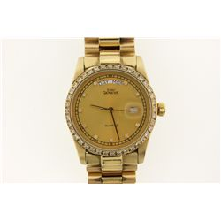 WATCH: [1] Men's 14ky watch; gold tone face, date @ 3:00, day @ 12:00; forty (40) rb diamonds; 1.8mm
