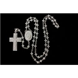 ROSARY:  [1] Platinum rosary with an 18KWG cross is set with round, baguette and princess cut diamon