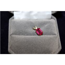 10 KT GOLD RUBY (1.45CT) AND DIAMOND PENDANT
