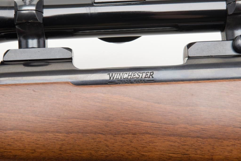 "Winchester Model 70 Lightweight bolt action rifle,  243 Win  cal , 22""  barrel, blue finish, checke"
