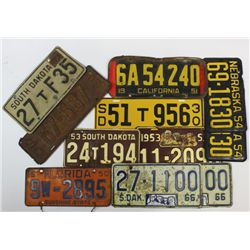 Collection of 11 license plates.