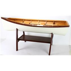 Miniature row boat coffee table on wood base