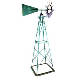 "Outdoor yard art windmill standing 97"" tall."