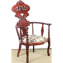 Fancy mahogany Victorian arm chair