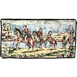 Vintage velour tapestry of cowboys on horseback