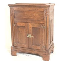 Large antique oak icebox features hinged top,
