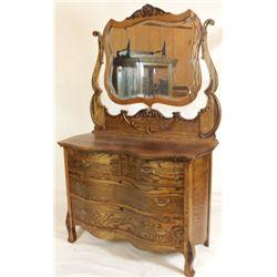 Antique serpentine front dresser
