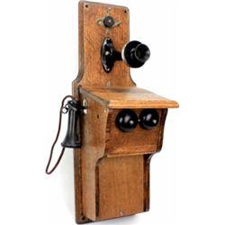 Antique oak wall phone.