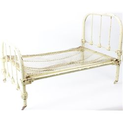 Interesting miniature iron bed by Art Bed Co.