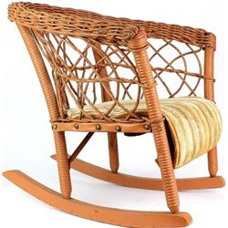 Early childs wicker rocking chair.
