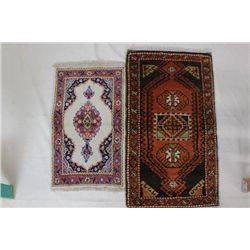 Collection of 2 hand woven rugs includes